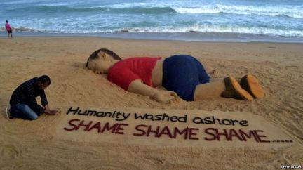 Indian artist Sudarsan Pattnaik created a sand sculpture of the image of Aylan Kurdi's body. Photo: Getty