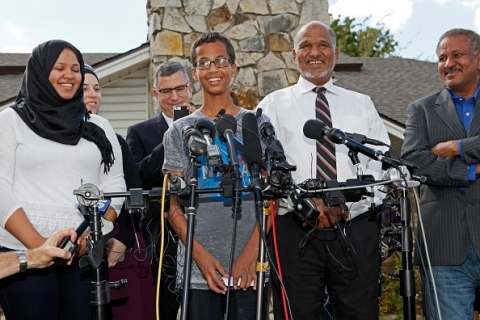 Ahmed Mohamed talking to reporters as his family expressed their appreciation by offering a pizza treat to reporters outside their Irving, Texas home. Photo: Getty Images