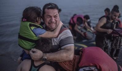 Relief as a family reach Kos, Greece. Photo: Daniel Etter