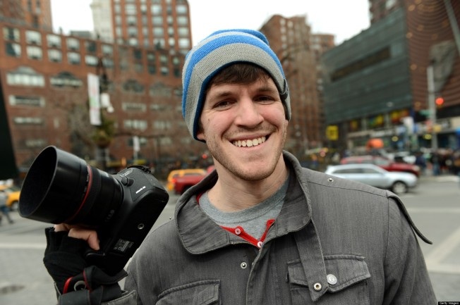 Brandon Stanton, creator of the Humans of New York blog, with his camera February 22, 2013 across the street from Union Square in New York. AFP PHOTO/Stan HONDA