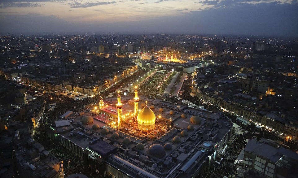 Millions of Muslims defy ISIS threats to visit shrine of Prophet Mohammad's grandson in Iraqi holy city of Karbala.