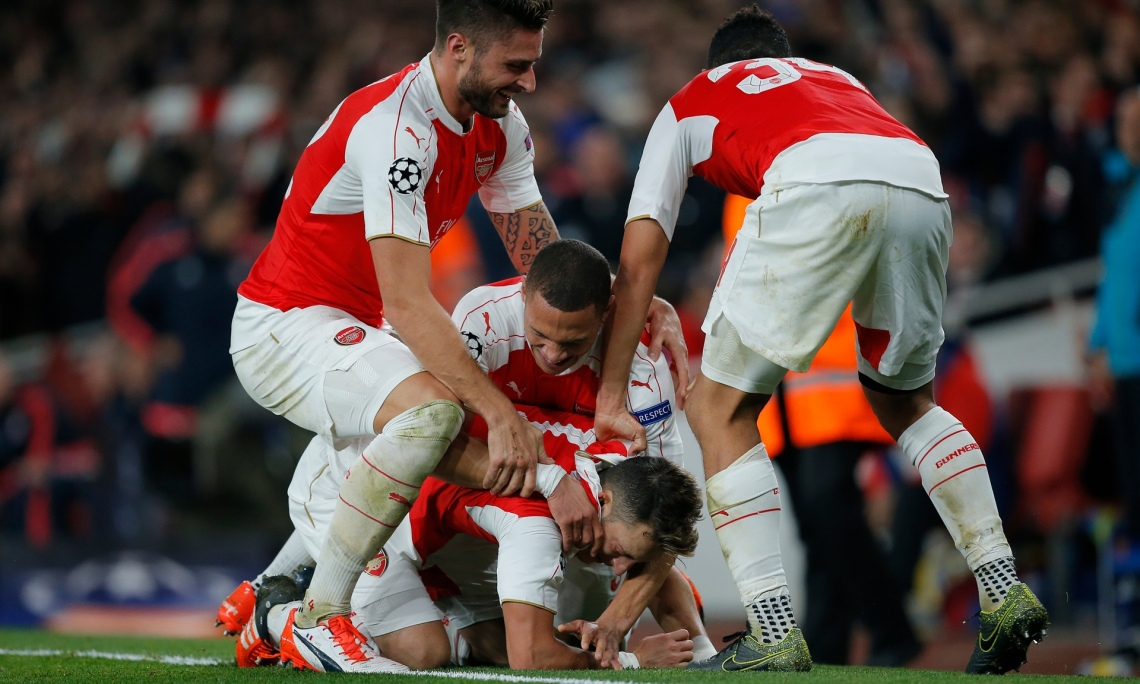 Arsenal Football Clubs players celebrate there second goal during their shocking win over Bayern Munich Photo: Guardian