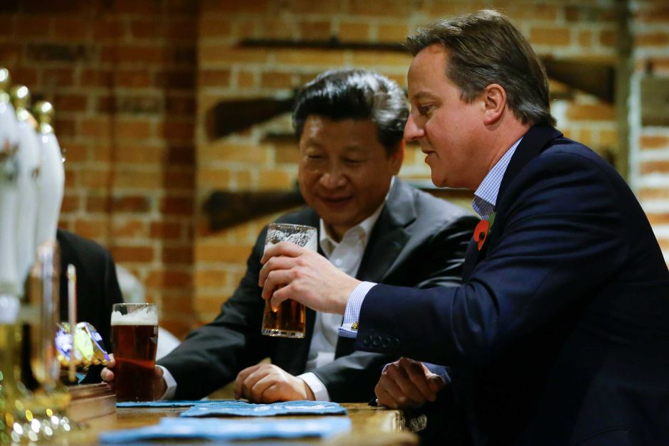 The British Prime minister drinks a pint of beer with the Chinese President Xi Jinping at a pub in North West London. The Chinese Premier is currently in England as a part of a 4 day tour to improve economic ties with Britain.