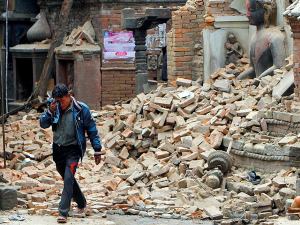 A Nepali man crying amongst rubble after the earthquake. Photo: new.nationalpost.com