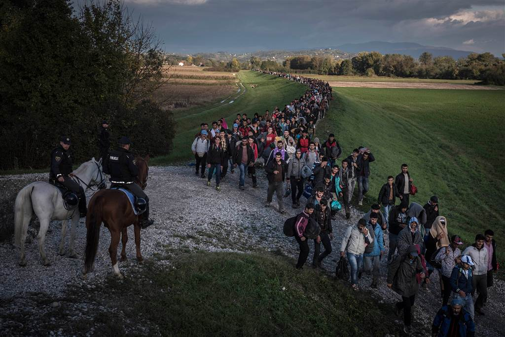 4. Police on horseback escort hundreds of migrants after they crossed from Croatia into Dobova, Slovenia, Oct. 20. As the number of migrants continues to rise, so do fears of unrest, crime and even Islamic State fighters hiding in the continuing stream of people.