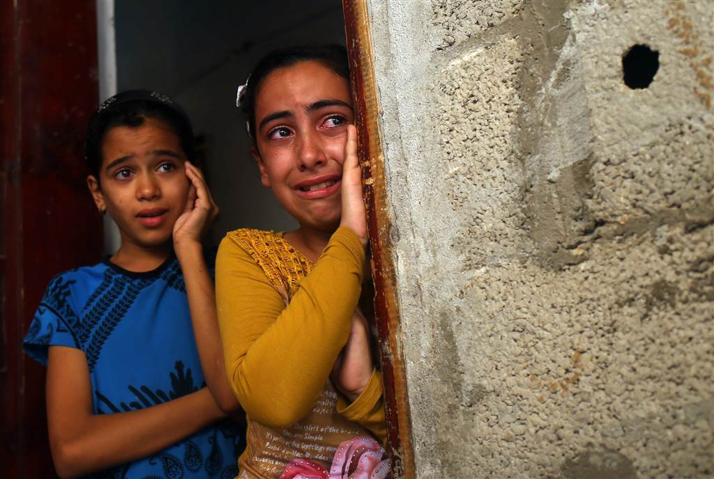 Palestinian relatives of Ahmed al-Serhi weep during his funeral in Deir al-Balah, in central Gaza. He was killed by Israeli forces the previous day in clashes at the border fence which separates the Gaza Strip from Israel.