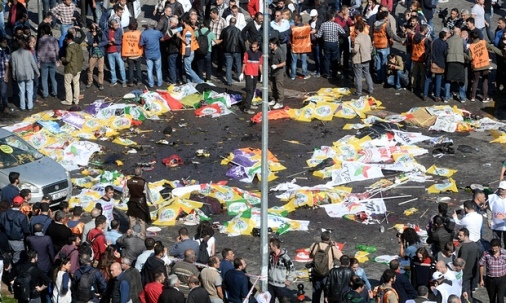 Victims lie on the street in Ankara as the scene of the explosion is cordoned off . Photo: Anadolu Agency/Getty Images